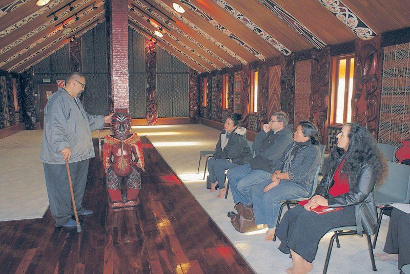 Manuel Beazley explains the significance of a carving of Te Wherowhero at Te Wai Ariki whare in Otara.